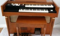 Beautiful 1960's Lowrey 'Holiday' model organ. Excellent condition. Sounds very good but would recommend a tune-up. Comes with original manual and sheet music/books, also in excellent condition. PICK-UP ONLY. Willing to donate!