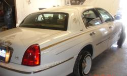 Selling a 1998 Lincoln town car asking $7500 for it, car is white with gold leafing & silver leafing on entire car, interior is tan, frame is fully reinforced all the way around, car runs really good, for more information or if interested about this car