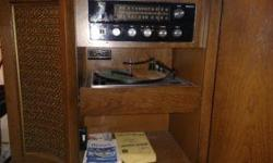 New Floor Model Magnavox Stereo AM/FM Radio and Record Turntable. Very Nice Sound.