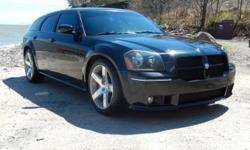 This 2006 Magnum SRT features the awesome 6.1L HEMI engine which produces 425HP and 420ft-lbs of torque! Mated to the 6.1L, putting the power to the wheels, is the stout W5A580 5-speed automatic transmission. Since completing the rebuild we have put fresh