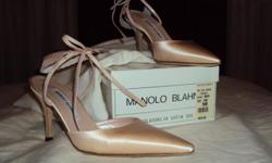 Pink satin Manolo Blahnik high heeled sling-backshoes in size 5. Fit woman sizes 5 to 6. Back ruffle at heel is removable. Never been worn. Original price $575.