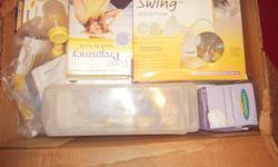 150$ breast pump used 2x still in box..pregnancy books...breast nursing pads nib breast milk bags nib, breast milk bag holder for freezer...etc.... --