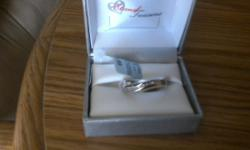 Men's silver er w diamonds si,e 10 & 12 never worn call 925 238-4665