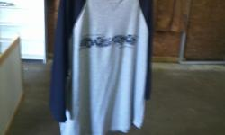 I have a number of these shirts. The one pictured is an extra large.  2 for $3.00  and they are new.    This is in