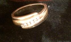 10 K Mens White & Yellow Gold ring. Back is all filledin with white gold. 6 SSI dimonds. Paid $1800.00
