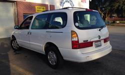 EXCELLENT ! ECONOMIC .White minivan 6cEverything works 2001 .185.000 miles