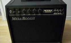 Mesa Boogie Rocket Reverb Combo Amp Amplifier All Tube 20 watts of class A power Beautiful condition. Tolex has no scuff or marks. This amp rocks and is adequate for bar gigs and clubs If you want to save on space in your trunk, but not sacrifice on sound