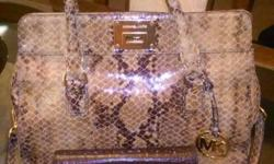 Beautiful MK bag, comes with wallet. Asking $275.00 paid $620.00