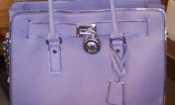 MK purse silver in color, beautiful bag. I have receipts. Will sell with wallet. I am asking $275 firm.