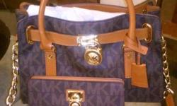 Micheal Kors purse excellent condition asking $225.00. Comes with wallet, also have receipts.