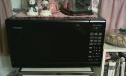 """Panasonic microwave oven. 14 amps. outside dimensions14"""" x 23 7/16"""" x 163/4"""""""