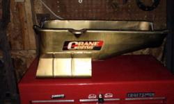 NW INDY- 7qrt. Milodon oil pan w/passenger side dip. High volume oil pump & pick up included.For SBC.Jegs pt.#697-30901Fits yrs. 1980-1985.Please call after 5:30pm & ask to speak to Steve about auto parts.CASH ONLY NO TRADES.