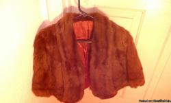 Mink stole in good condition. Given to me as a gift but I will never wear it. It needs to be owned by someone who will actually wear it, otherwise it is a waste of a nice article of clothing. Cash only, no checks.