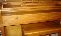 BEAUTIFUL IN MINT CONDITION PIANO CONSOLE. INSIDE HAS A THERMOSTAT SYSTEM TO CONTROL TEMPERATURE TO PREVENT CRACKS AND RUST. MEDIUM OAK COLOR. ALL KEYS IN MINT CONDITION. MUST SELL.
