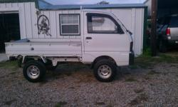 Great for the ranch or for hunters. Four wheel drive, lift kit with custom wheels. Nice bed for hauling feed or most anything. Heater works great, no a/c. 36375 miles/kilometers?