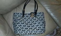 I gota couple purses that im selling cuz dey are getn in the way its a michael kors purse i bought a couples months ago an hardly used its not torn or anythng since i barely used it an two ecko purses that i purchase the same time i got the mk purse the