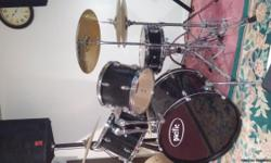 Pacific brand 8 piece Drum set in very good condition with upgraded brass cymbals.