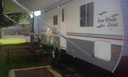 26 ft one mega slide fully self contained four winds by Dutchman No leaks or soft spots stored inside great condition inside and out everything in workin order a/c double door fridge 3 burner range with built in microwave spare tire stab jacks rollout