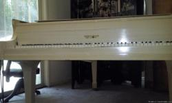 Kranich & Bach Antique white baby grand piano in Good condition About 30 years old with regular wear and tear ( Chip on left side of keyboard, chippped and regular discoloration of left corner of keyboard and bench,crack on left side of sliding