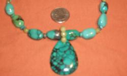 This is a piece I picked up is south west Arizona years ago. These are some of the best stones you will ever see. The necklace stones are as big around as your ring finger and the drop is shown with a quarter for size.
