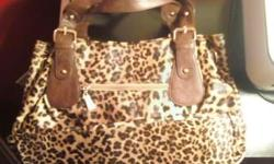 MEDIUM-SIZED BROWN LEOPARD CMG PURSE FOR SALE!!! I bought this purse in the Philippines for 2, 499.00 Philippine Pesos (this equivalents to about $57.00 U.S. Dollars) In the Philippines, CMG purses are like our Coach purses (very expensive and fabulous