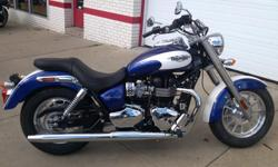 FOR SALE - BRAND NEW 2013 TRIUMPH AMERICA. TWO TONE BLUE AND WHITE. 865 CC PARALLEL TWIN ENGINE AND A FIVE SPEED TRANSMISSION. AWESOME MID SIZE CRUISER WITH REAL STYLE AND GREAT FIT AND FINISH. THIS IS A BRAND NEW BIKE THAT COMES WITH A FULL 2 YEAR