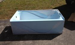 Brand new bathtub never used still in the plastic. White, left hand drain. $200.00 O.B.O. Call () -