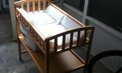 New born baby crib in very good condition,brown frame with new whitemattress and storage container included cell -.