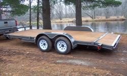 """I have 2 new car haulers that were used once to bring tractors from Texas. I baught these right from factory at wholeslae prices and will sell them for the same. These trailers can be loaded from the end or from the sides. They are 18ft X83"""" wide,2"""