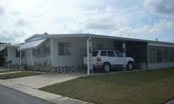 2 BR 1.5 B. Nice Mobile Home with incredible amenities (streets surveillance, side walks, lake, heated pool, social club, close to the parks and the beaches of the Gulf) in one of the best Mobile Homes Park in New Port Richey-Florida: $412 per month