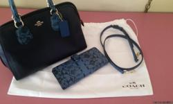 Brand new navy blue with snakeskin accent and matching wallet. New both were $490. Asking $350