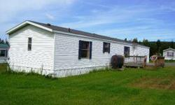 Nice home in park with large yard. Home features large deck on one side and smaller deck on other. Lots of room to add a shed for snowmobiles or ATV's. Large open living area with new appliances including a washer/dryer. Mstr bdrm features full bathroom.