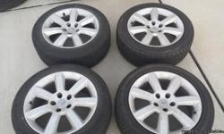 Nissan tires and rims P235/50R17from a 2004 350zvery nice and clean tires are not all a match but close a lot of tread..asking$180 .....for more info call mark 3174643335
