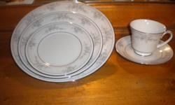 """Five, five piece place settings of """"Sweet Leilani"""" china by Noritake. There is also a sixth place setting that is missing the coffee cup that will be included in the $100.00 price. Pieces are in perfect condition, never been used. $100.00 or best offer."""
