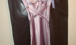 Purchased at the Vera Wang boutique in Seoul, Korea. Never worn. Tags still on dress. 931-729-3554