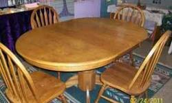 """Round with a removable leaf. The picture tells 1,000 words better than I can? I have two of them, table is 30.5"""" high, without the 18"""" leaf it measures 42"""" round. The chairs, four for each table have a chair back height of 38"""". They were used at our store"""
