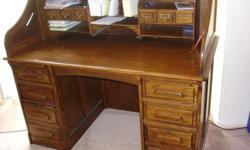 BEAUTIFUL OAK TOP ROLL DESK IN MINT CONDITION. DARK BROWN COLOR. MUST SELL. ALSO HAS AN OAK CHAIR.