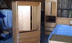 This is a oakwood full King size bedroom set, It has plenty of storage on both sides of bed and underneath the mattress. i have it stored in a shop now and have no use for it now. I had it custom made for me and hate to get rid of it !