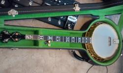 this is a 1979 ode model D 5 string banjo it has a new frank neat walnut neck and a cox maple wood rim it also has a tony pass old wood rim that comes with it and a hard shell case this banjo sounds and plays fantastic must see. cell# 863-414-0090