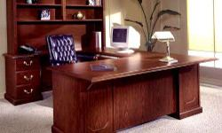U-Shaped cherrywood office desk with credenza in excellent condition for sale. $800 or best offer. I have a left and a right. They are both in excellent condition. We had custom glass toppping made for each of the desk. If
