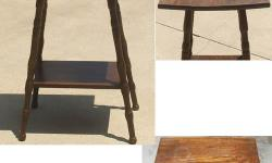 """This is a very old vintage primitive table stand. 20"""" x 15 1/2"""" x 29 1/2"""" tall. As you can see in the picture the wood top is curved it does have some water marks from a glass and some scratches that need to have a good polish. Great side table."""