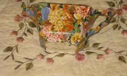 This creamer cup is a fine peace made by fenton with a very nice flower pattern