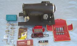 Old Sewing Machine: 1947 Kenmore Electric Rotary Sewing Machine, model 117-959, includes instruction book, rotary attachments & Kenmore buttonholer, DC & AC to 60 cycle, 110 volts, 80 watts, .8 amps, manufactured by Sear Roebuck and Company, used, $100.,