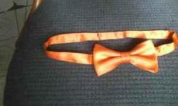 Spice up your wardrobe with this handsome menswear classic. Eye-catching orange, this versatile pre-tied bowtie will help you look your best without the hassle of a freestyle bowtie. Be it at a wedding, work party, school dance, or any other formal