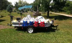 Paddle wheeler3 comes with marine battery 55 pound thrust minn Kota electric boat motor 4 life jackets 2 15 poundanchors 6x8 tilt bed trailer
