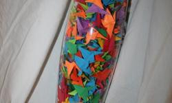 Tall vase about 2.5' filled with hand made paper cranes perfect gift for any household, apartment or dorm email or text (call only after 4 please) 214-675-3009