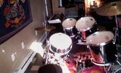 this 5-piece performance quality, professional not a toy, Pearl drum set is priced to sell quickly ... with 2 additional added hi hat and cymbals. shiny black finish with bench included.. paid Over $700.00 brand new this set is used and selling for 300.00