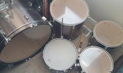 Percussion Plus drumset. 5 drums: 2 suspended toms, 1 floor tom, base drum, and snar drum. cymbals have been up graded to Sabian brand the stand for the high hat and crash are included pluse a bonus crash. 2 sets of sticks and the stool. Set has hardly