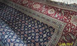 this rug is beautiful, it has a very tiny hole but is in excellent condition