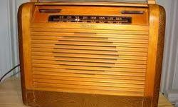 This is a Philco Roll Top Portable Radio. It is in decent condition for the age of it. Leather on the sides and bottom. It is missing the top leather strap. Great for any collection.